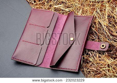 Hand Made Dark Magenta Leather Man Wallet .man Clutch. Multi Colored. Leather Craft.on Dark Backgrou