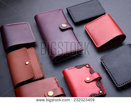 Set Of Hand Made Leather Man Wallet . Multi Colored. Leather Craft.on Dark Background.top View