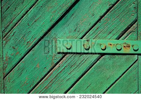 A Fragment Of An Old, Painted, Wooden Door With Hinges