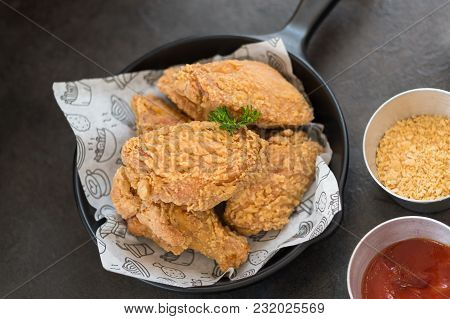 Delicious Fried Chicken Wings On The Small Pan With Sauce. Focus On The Parsley.
