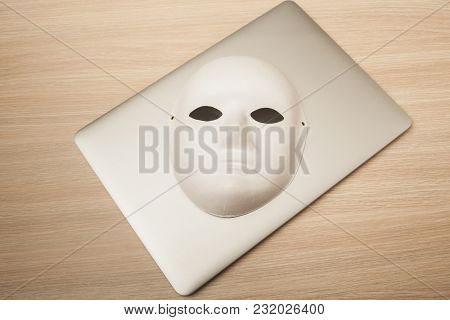 Conceptual Photo, Mask On A Laptop As A Symbol Of A Hacker Attack