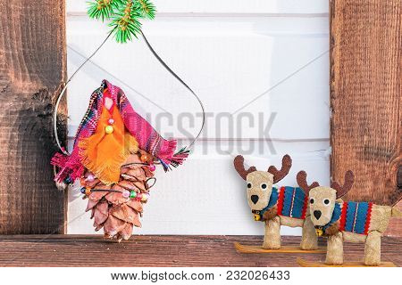Toy From The Buds Of Cedar And Fabric With A Branch Of Blue Spruce On Wooden Background, Fairy Chris