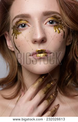Woman A Freckle Golden Tears On The Face. Portrait Of Pretty Beautiful Female Model With A Perfect S