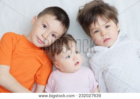 Happy Kids, Three Children Different Ages Lying, Portrait Of Boy, Little Girl And Baby Girl, Happine