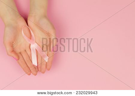 Woman Hand With Pink Tape As Symbol Of Women Illness Mammary Cancer Isolated On Pink Background