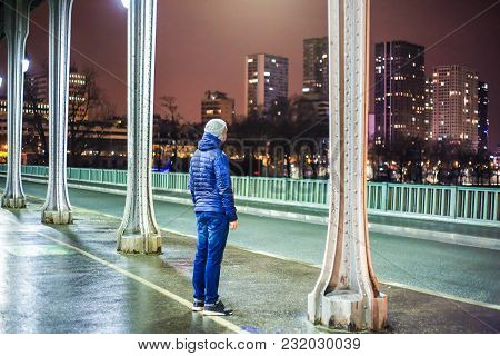 Young Casual Man Standing On Bir Hakeim Bridge In Paris, France During Sunset. Back View Of Guy In B