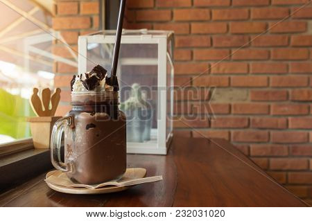Dark Chocolate Milk Shake With Whipped Cream Brownie On Wood Table, Window Cafe Background, Beverage