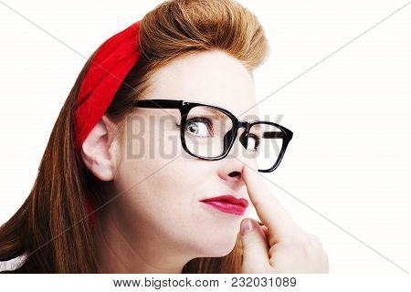 Fashionable Redhead Woman In Pin Up Style In Studio.