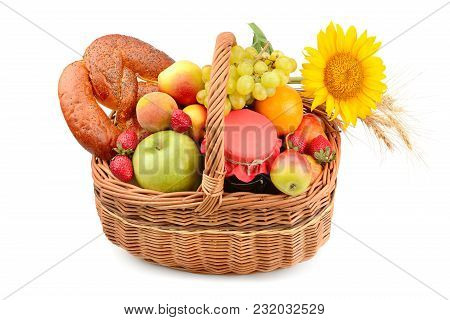 Organic Food Isolated On White Background. A Set Of Fruits And Pastries In A Woven Basket.