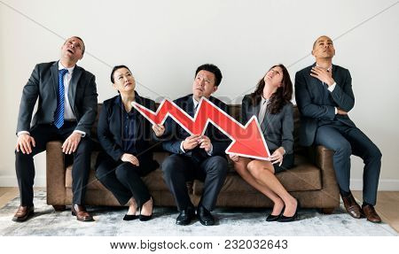 Business people sitting together with statistics icon