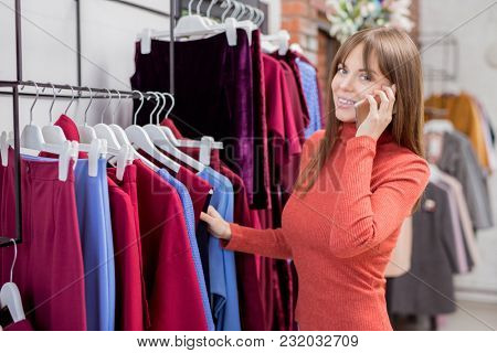 Working young girl in the store