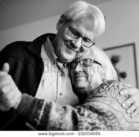 Black and white photo of senior couple dancing