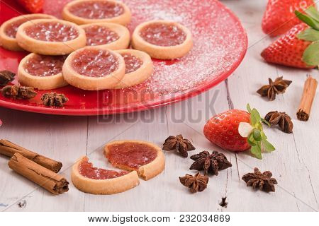 Strawberry Tartlets With Spices On Red Dish.