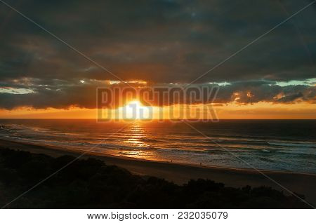 Early Sunrise At The Indian Ocean Beach, Seascape, Landscape With Silhouettes Of People Walking Alon