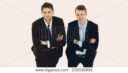 in full growth.two serious business partners standing,isolated o