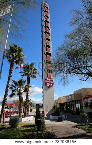 Baker, California / 3-15-2018: The World's Tallest Thermometer is a landmark located in Baker, California, USA. It is an electric sign that commemorates the record 134 degrees Fahrenheit in 1913.