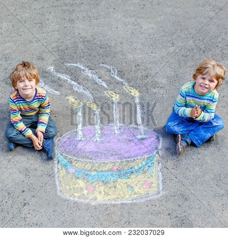 Two Happy Little Kids Having Fun With Big Birthday Cake Picture Drawing With Colorful Chalks. Creati