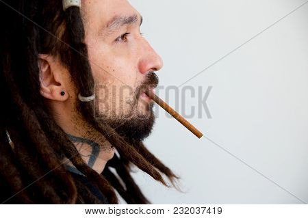 Quit Smoking Concept - Man Smoking A Cigarette