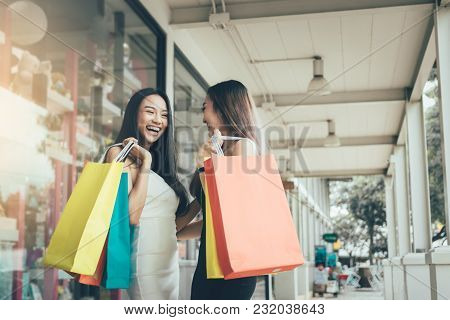 Two People Asian Woman Funny And Happy About Shopping At The Outlet Together.