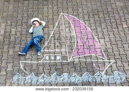 Little Kid Boy As Pirate On Ship Or Sailingboat Picture Painting With Colorful Chalks On Asphalt. Cr
