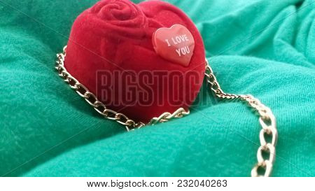 A Red Ring Box And A Red Love Heart Inscribed,