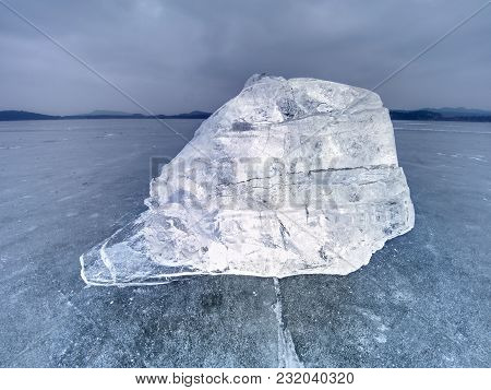 Ice Floe And Crushed Ice On Dark Frozen And Flat  Ground. Shining Crushed Ice In Strong Colorful Bac