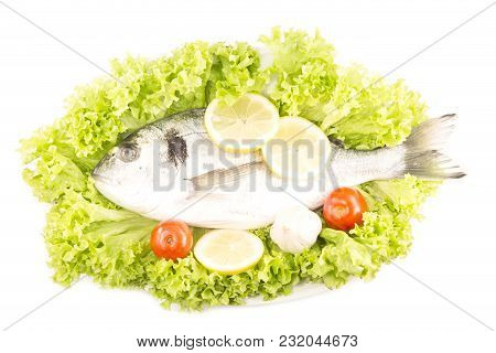 Dorade Fish With The Fresh Vegetables Isolated