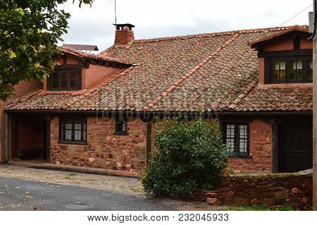 Picturesque Village With Its Red Slate Roofs In Madriguera. Architecture Vacation Travel Rural Life.