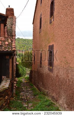Very Narrow Streets Of A Quaint Village With Its Black Slate Roofs In Madriguera. Architecture Vacat