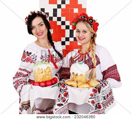 Two Beautiful Ukrainian Women In National Costumes With Easter Dishes