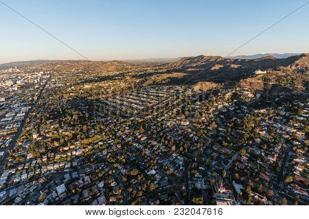 Los Angeles, California, USA - February 20, 2018:  Morning aerial view of the Hollywood Hills homes with Griffith Park and Hollywood Sign in background.