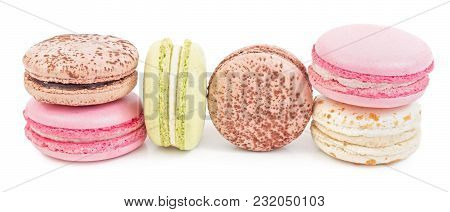 French Sweet Delicacy Macaroons Variety Closeup. Isolated On White Background.