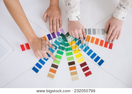 Close-up Shot Of Unrecognizable Interior Designers Using Color Palettes While Choosing Necessary Pai