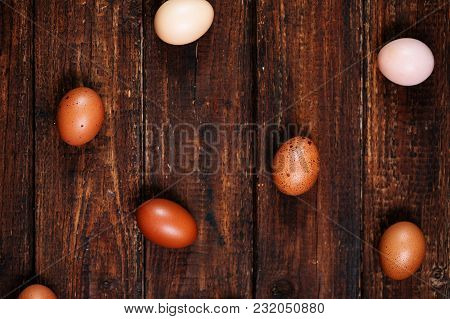 Brown Eggs On Wooden Background, Top View