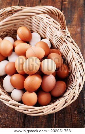 Many Fresh Organic Eggs In A Large Basket