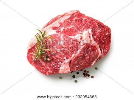 fresh raw rib eye steak isolated on white background, top view