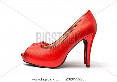Red High Heel Shoes In Front Of White Clean Background With Shadows