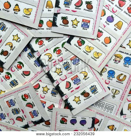 Bracknell, England - March 20, 2018: Used Paper Lottery Cards With Fruit Machine Symbols For Which C
