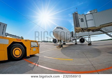 Parking At The Airport, Airplane At The Teletrap. Aerodrome Tractor Is Ready For Towing And Departur