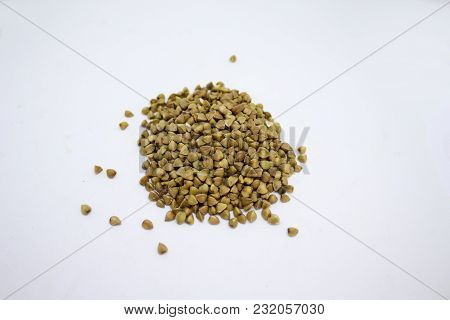 Some Spilled Buckwheat On A White Background