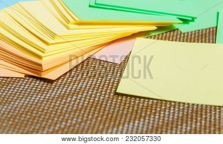 Stationary, Stack Of Blank Colored Sticker On Brown Board. Time-management, Planning