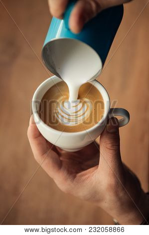 Hand Of Barista Making Latte Or Cappuccino Coffee Pouring Milk Making Latte Art