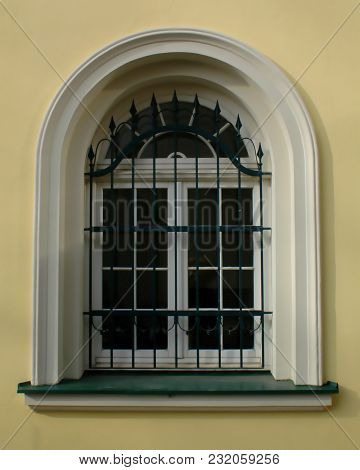 Old Renovated Window, Semicircular, Baroque, With Trellis And Yellow Plastering Around