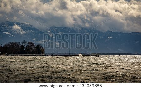 View Over Lake Constance Towards The Austrian Alps During A Winter Gale