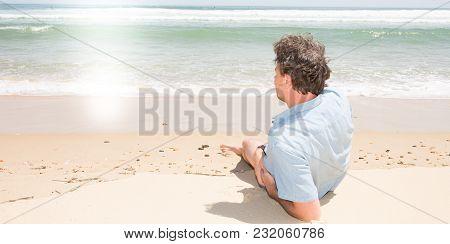 Rear View Alone Single Man Lying On Sea Side Sand Look Ocean Beach