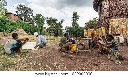 Lalibela, Ethiopia - September 2017: Unidentified Pilgrim Reading Bible At One Of The Old Rock Churc