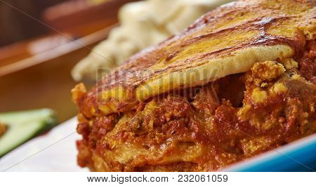 Mexican Cuisine , Mexican Tortilla Casserole, Traditional Assorted Dishes, Top View.