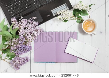 Beautiful Branch Of White And Violet Lilac Flowers With Opened Note-book, Pad And Black Opened Lapto