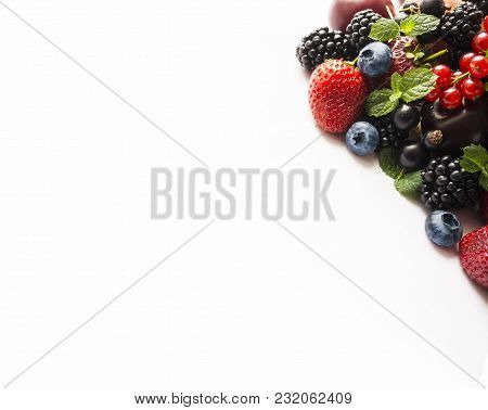 Top View. Mix Berries On A White With Copy Space For Text. Ripe Blackberries, Blueberries, Strawberr