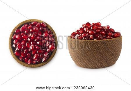 Bowl With Pomegranate Seeds Isolated On White Background. Ripe Pomegranates Close-up. Sweet And Juic